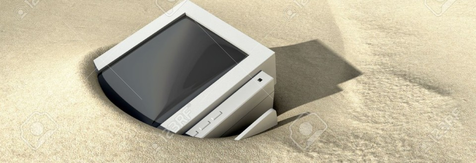 A computer buried in the sand