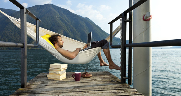 Man on a hammock with his laptop